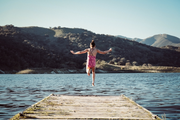 Girl jumps from pier into water