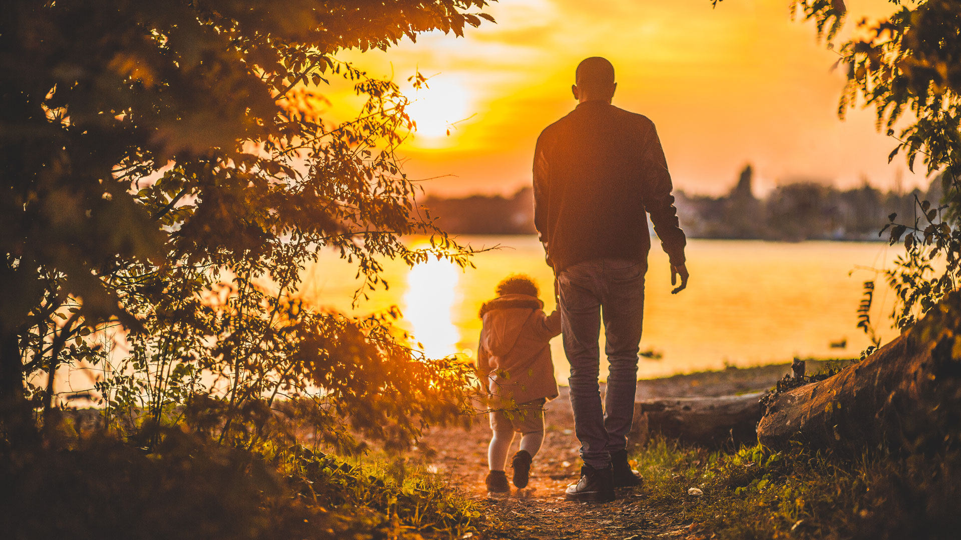 A child with dad walking