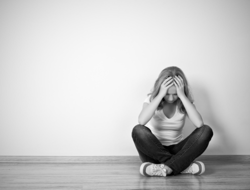 teen-girl-depressed-sitting-mono2160
