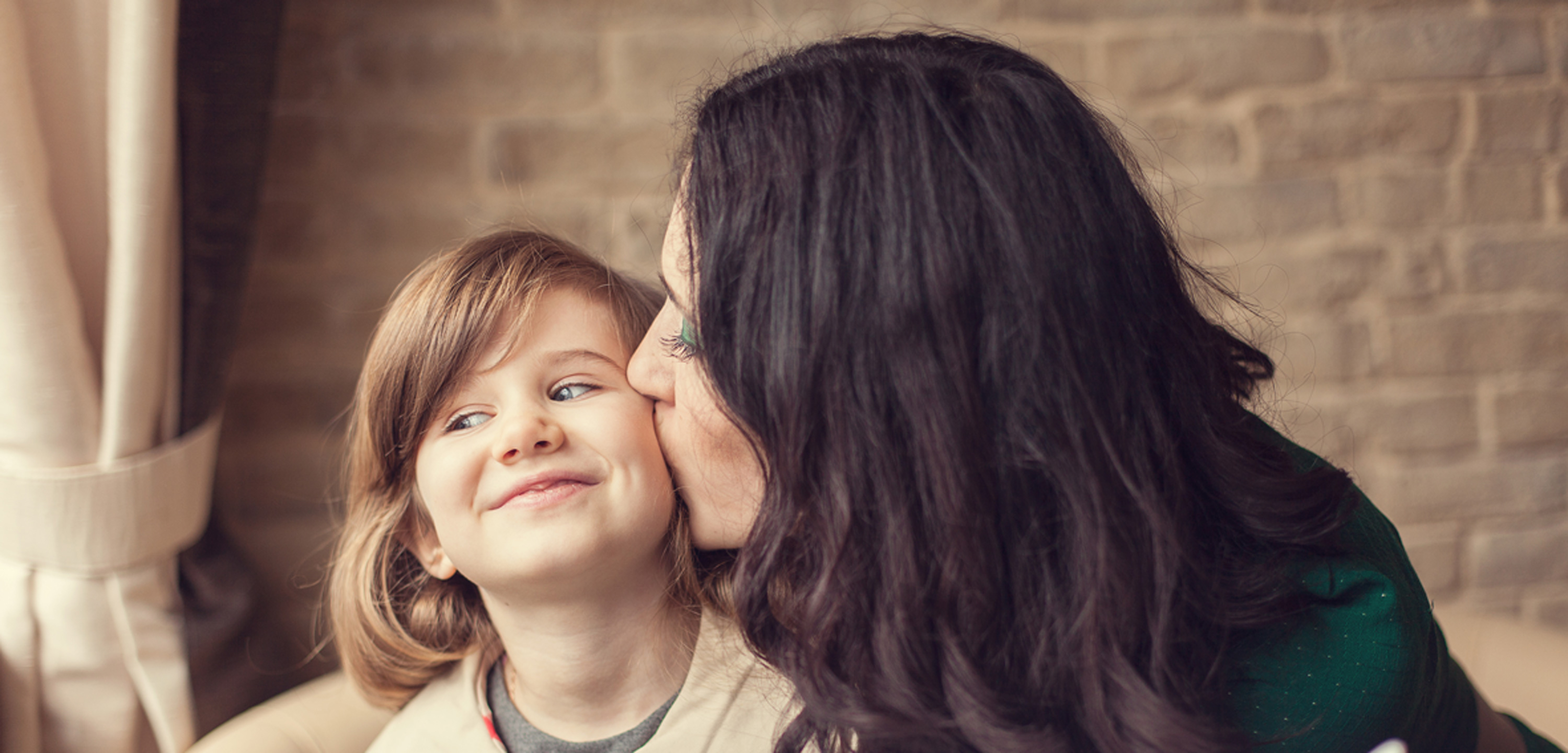 Mother-Kissing-Dauther-on-Cheek1440