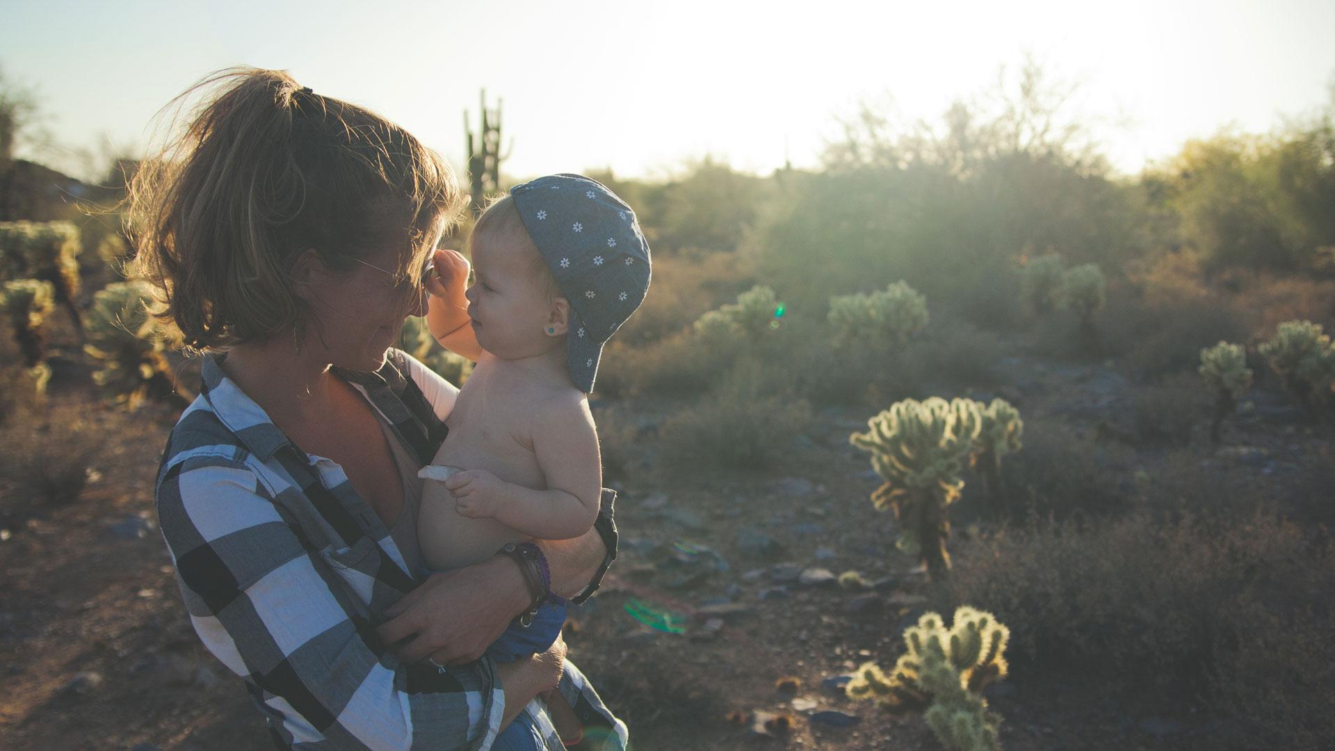 Baby and mum at sunset