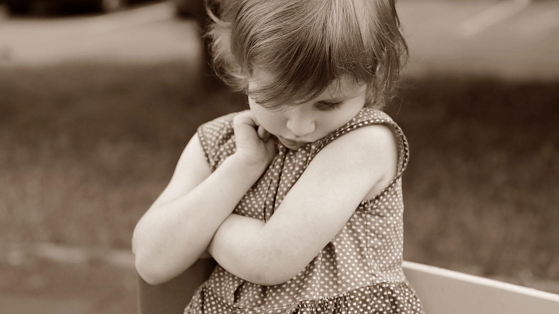 Little girl looking worried