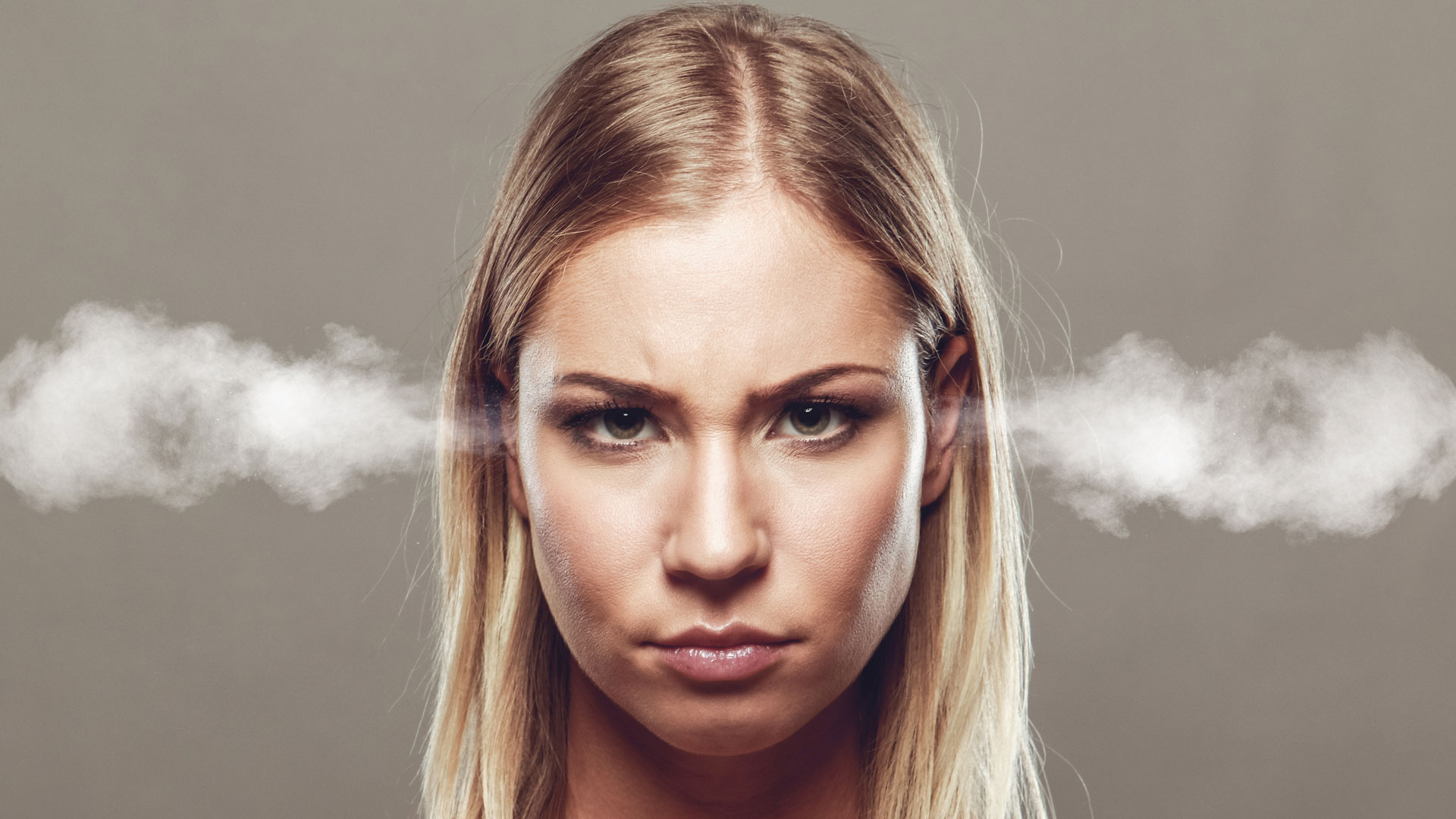 Woman with steam coming out her ears