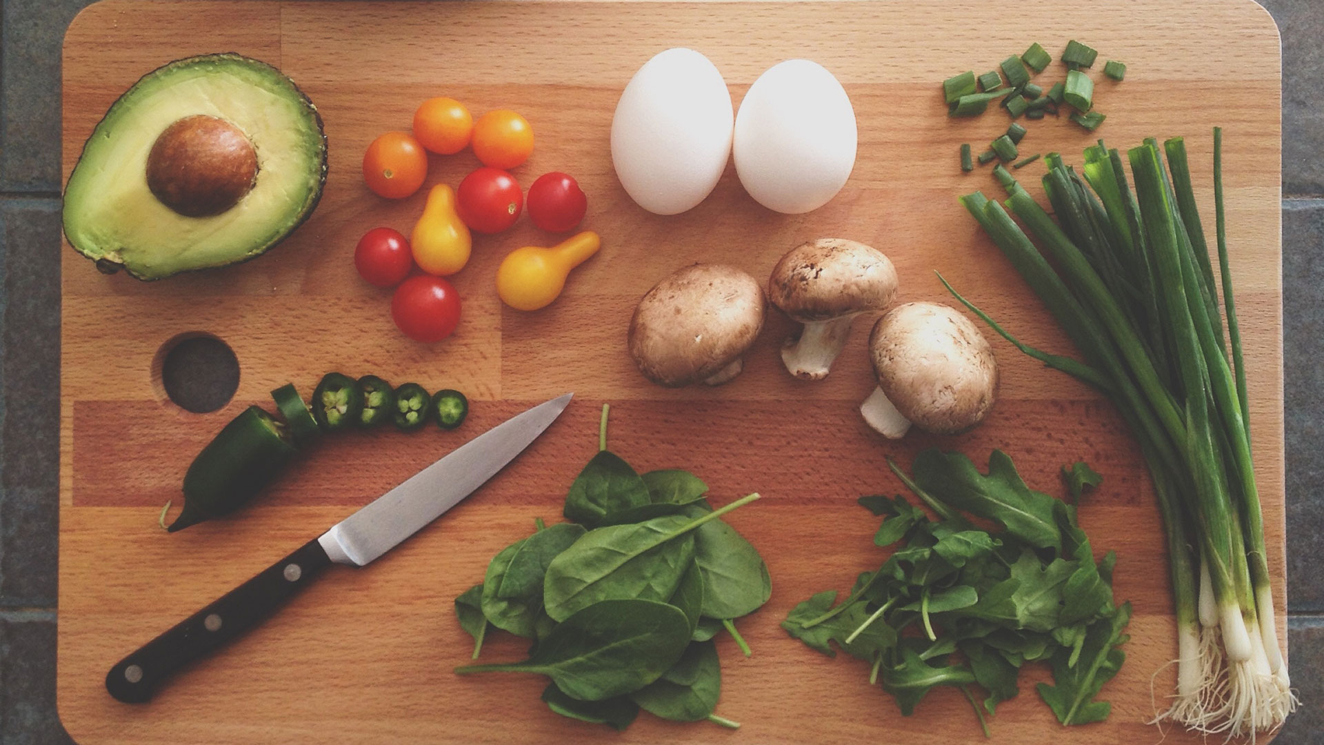 Chopping board with fresh vegetable