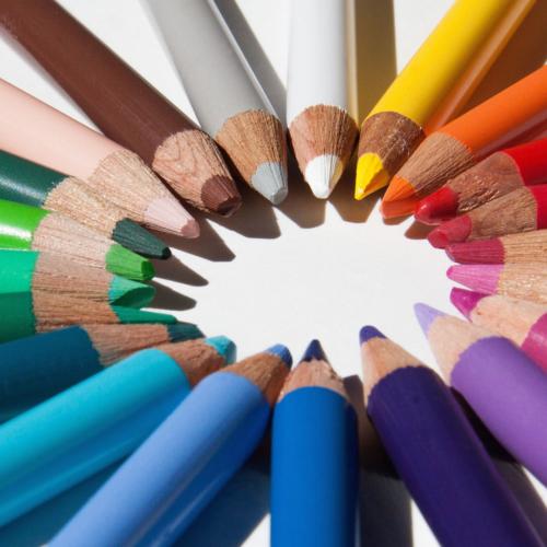 A circle of rainbow pencils.