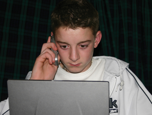 boy-on-laptop-and-mobilephone1440