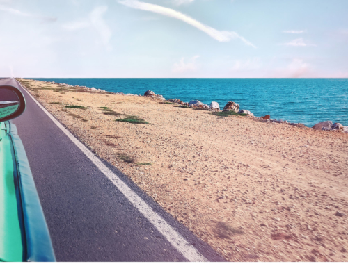 car-on-road-beach2160