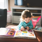toddler-withbook-on-table2160