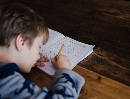 boy-writing-maths-homework2160