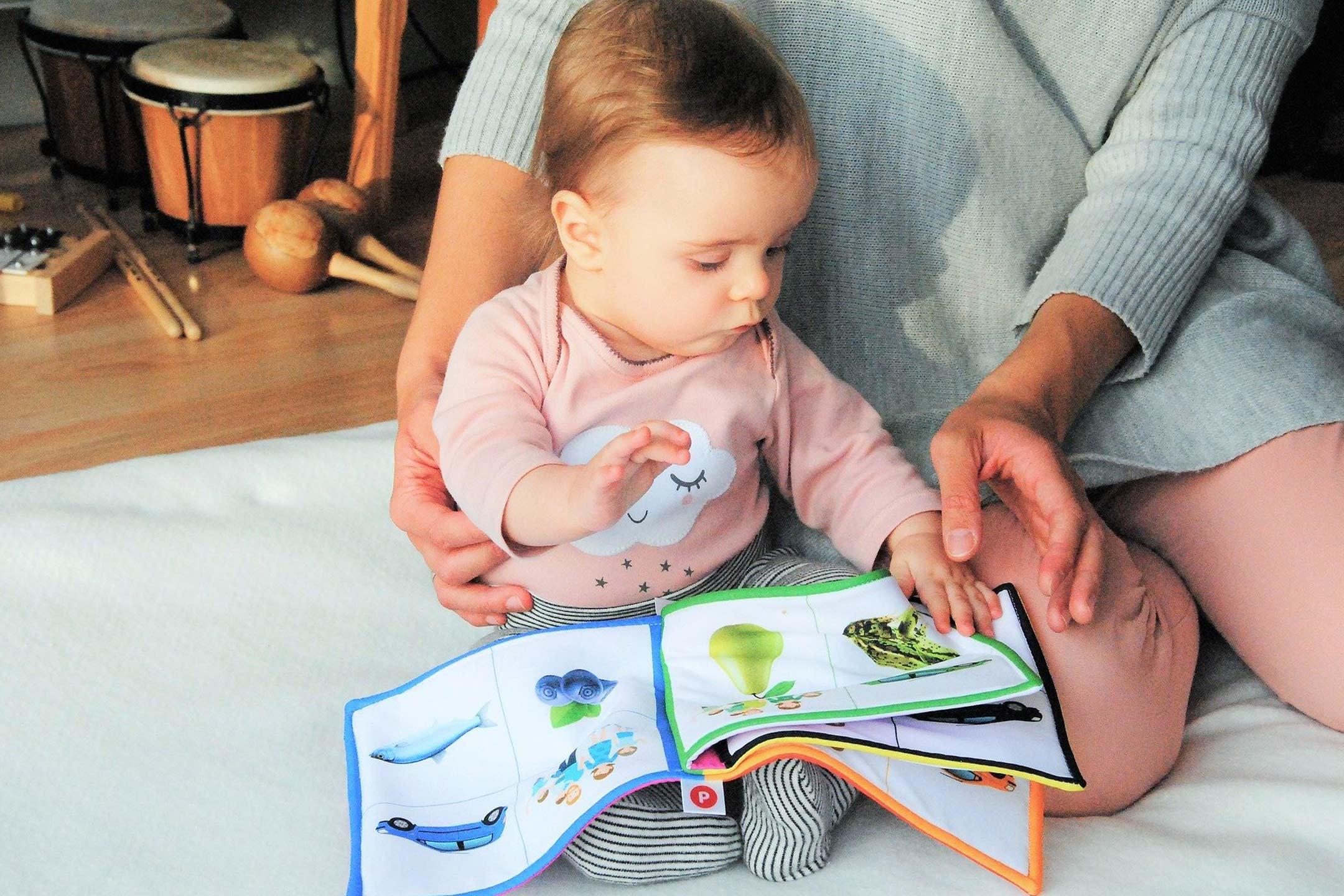 child-mum-reading-cloth-book2160