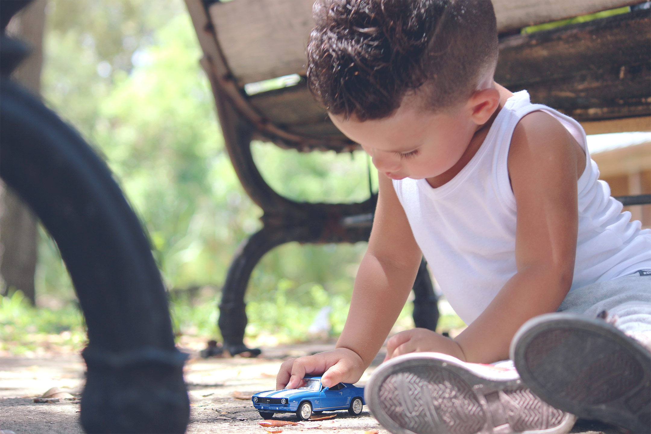toddler-playing-with-toy-car2160