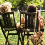 two-kids-reading-outside2160