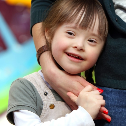 Down-syndrome-girl-happy-with-mother2160