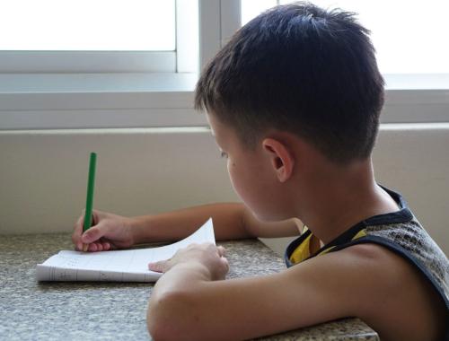 boy-writing-at-table2160