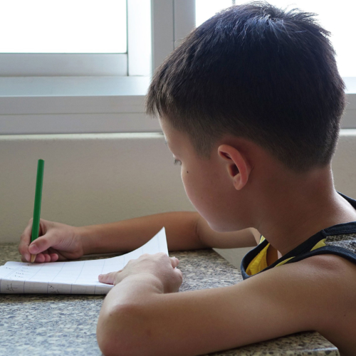 boy-writing-at-table2160