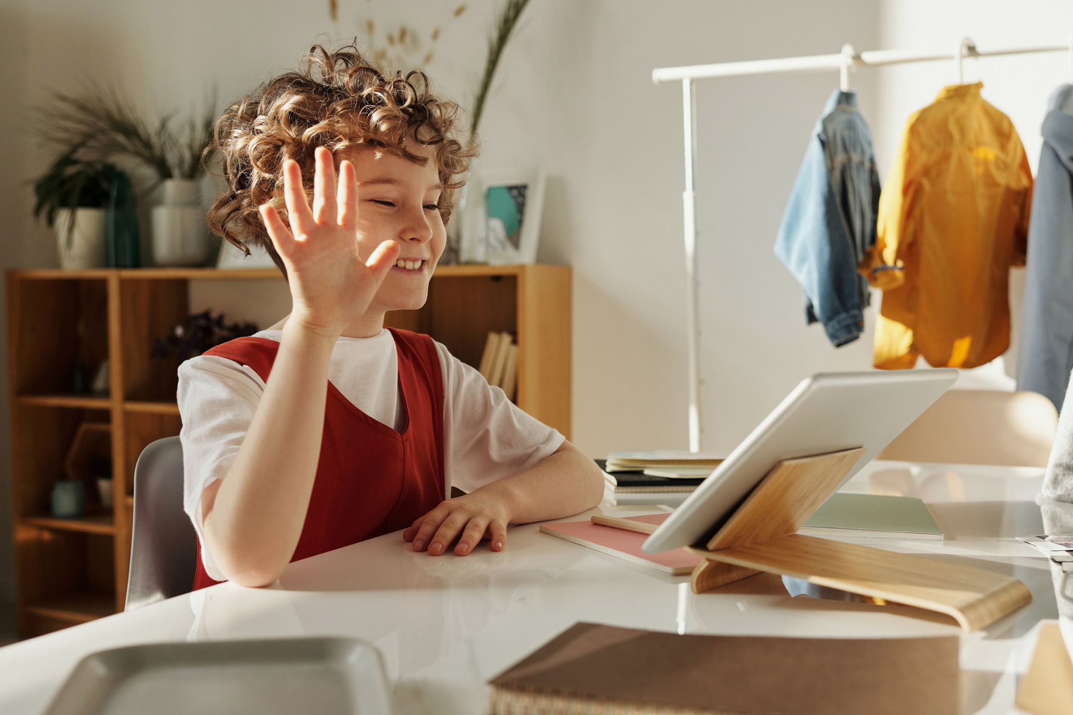 child-waving-at-tablet-video-call2160