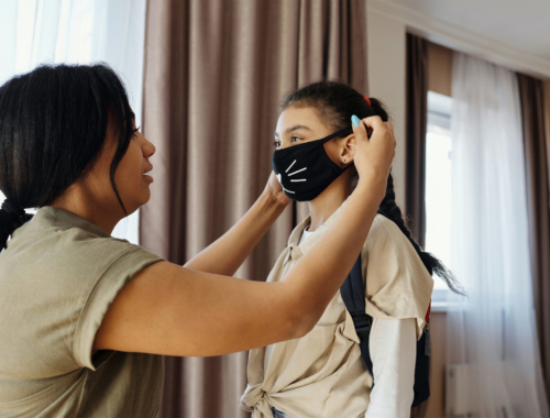 mother-and-daughter-puting-on-face-mask2160