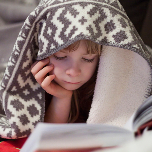 child-reading-under-cover2160