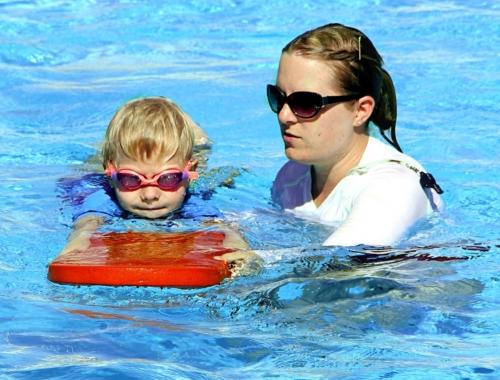 child-swimming-with-teacher2160