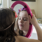 child-looking-in-mirror-2160