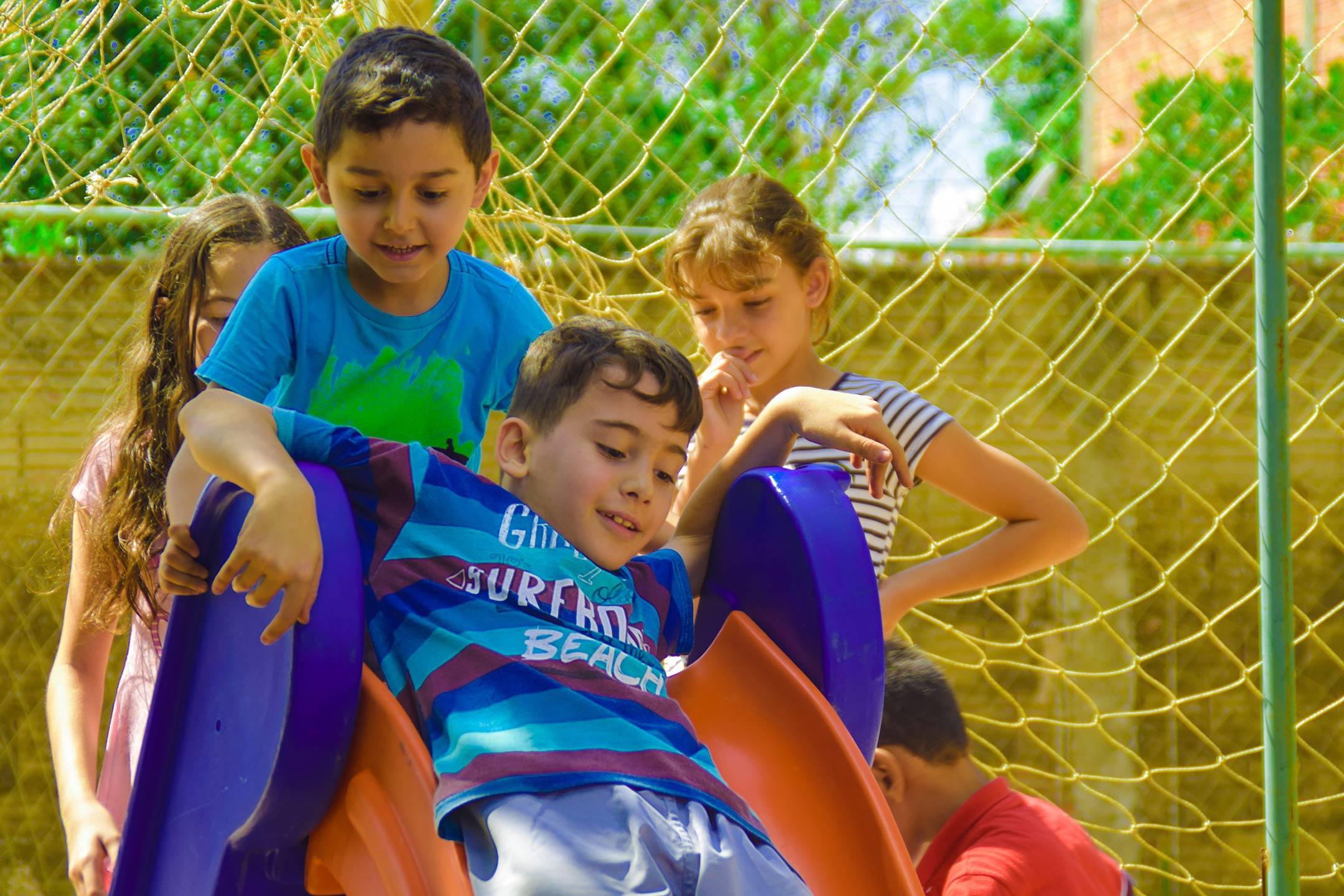 children-playing-on-slide2160