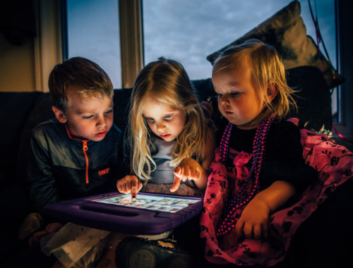 three-children-on-ipad-playing2160