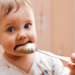 toddler-with-spoon-in-his-mouth2160