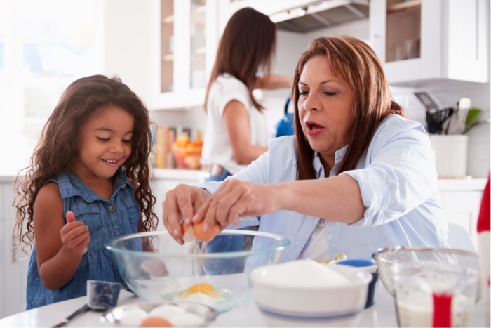 young-girl-cooking-with-grandma2160