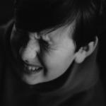 boy-eyes-scrunched-mono2160