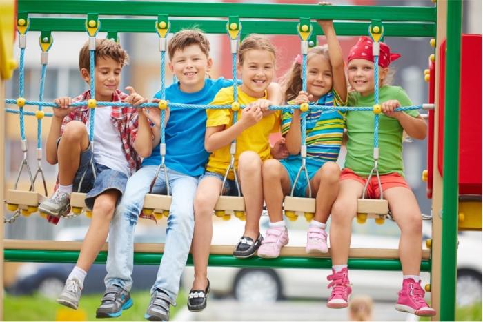 kids-friends-sitting-on-a-swing2160