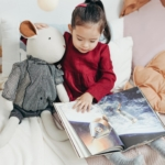 toddler-reading-to-toy2160