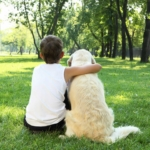 young-teen-hugging-dog-in-park2160