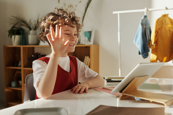child-smiling-waving-while-using-tablet2160