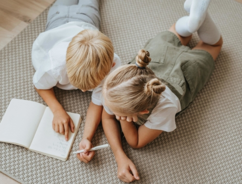 siblings-lying-down-writing2160