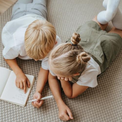 siblings-lying-down-writing2160