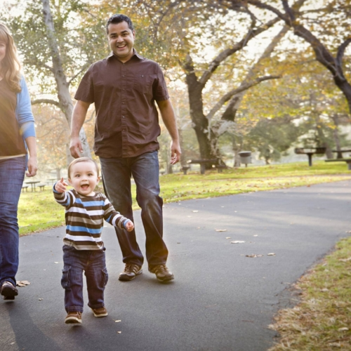 Family-walking-in-park-multicultural2160