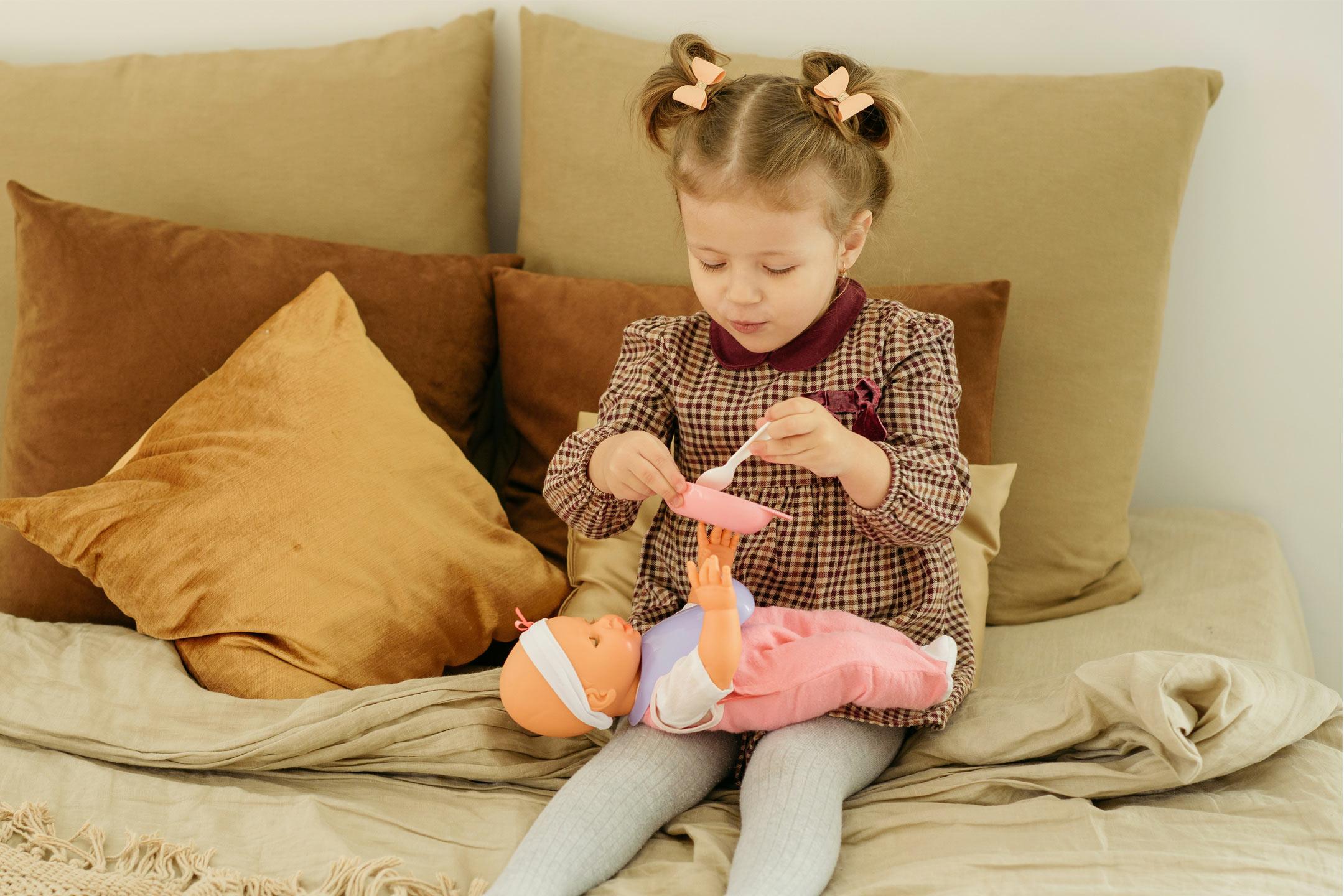 little-girl-feeding-doll2160