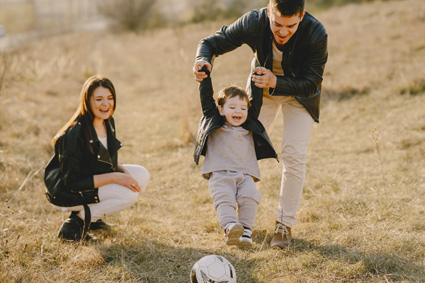 parents-playing-soccer-with-baby