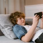 tween-boy-playing-on-iphone2160