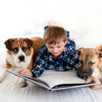 boy-reading-to-pet-dogs2160