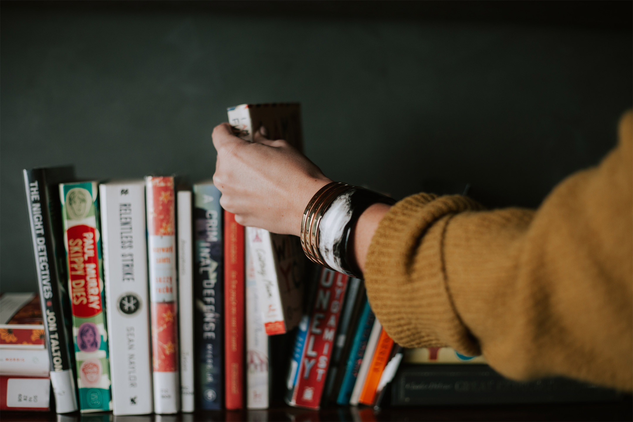 female-arm-reaching-for-book2160