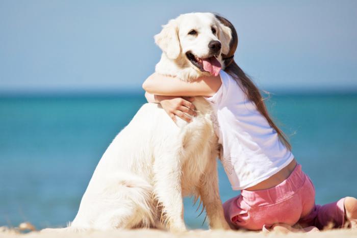girl-hugging-dog-on-beach2160