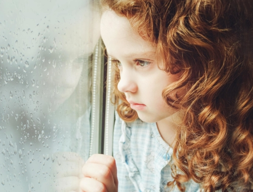 portrait-sad-girl-looking-out-window2160