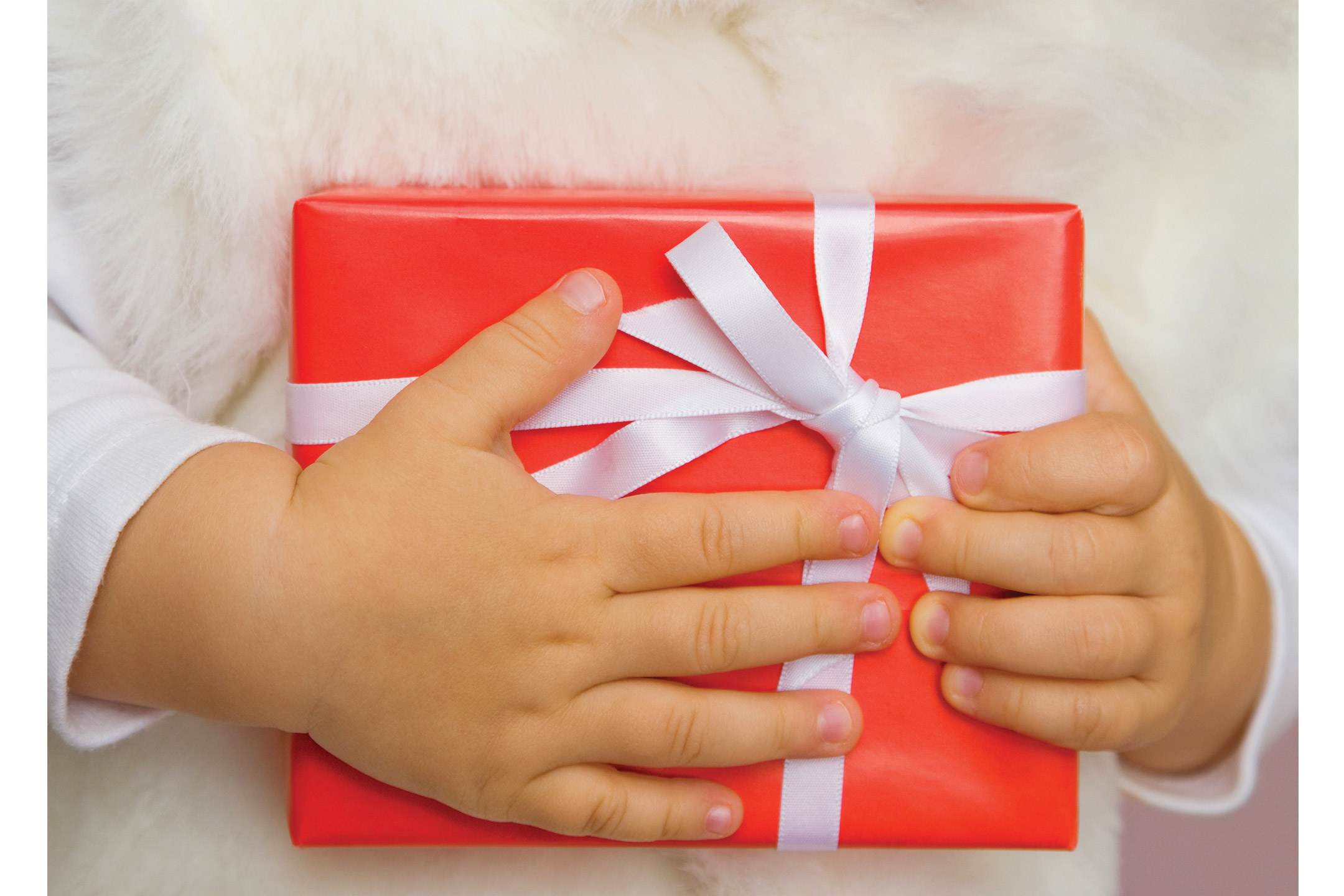 red-gift-clutched-by-child2160