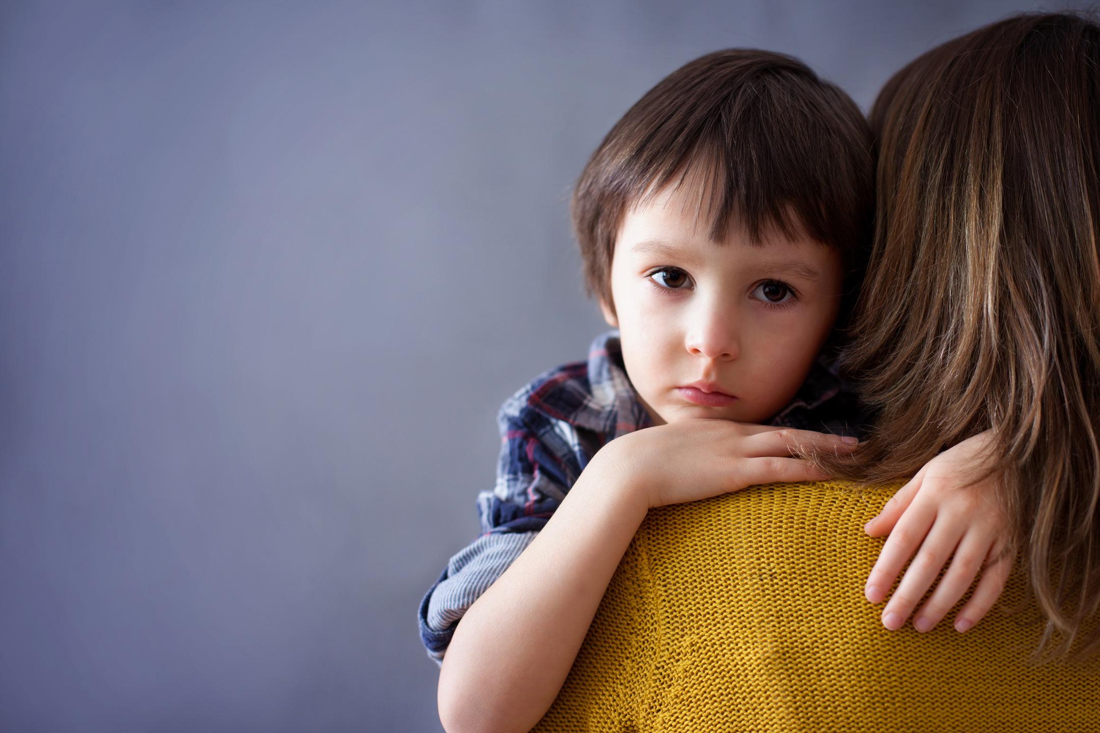 sad-little-boy-hugging-mother2160