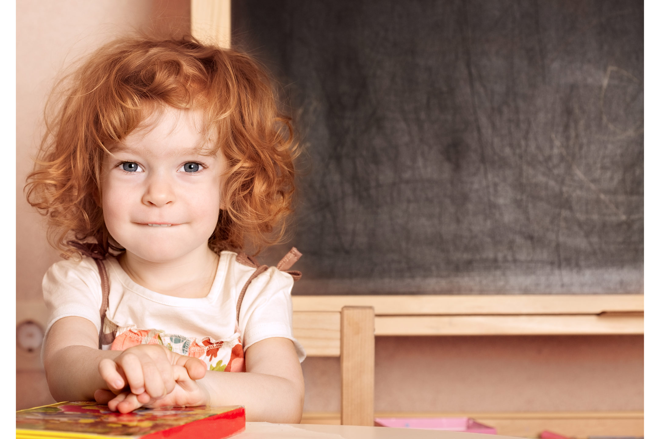 young-girl-with-book-at-kindy2160