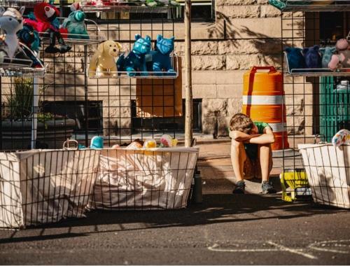boy-selling-toys-outside2160