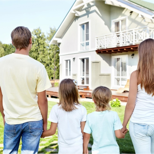 family-looking-at-house2160