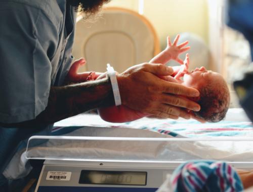 newborn-held-in-delivery-room