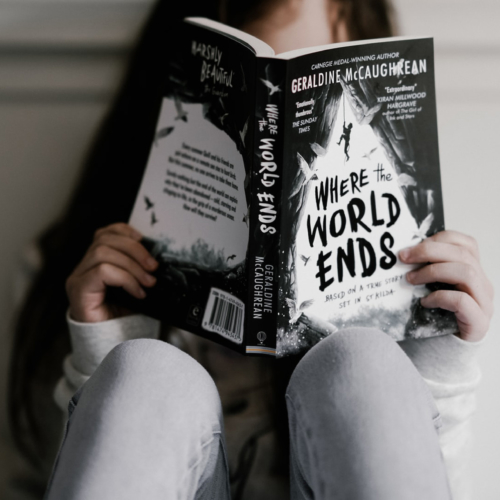 Girl-reading-book-grey-colours2160